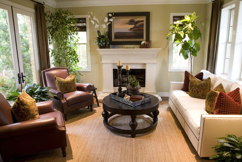 Traditional formal living room with cozy furniture and white fireplace