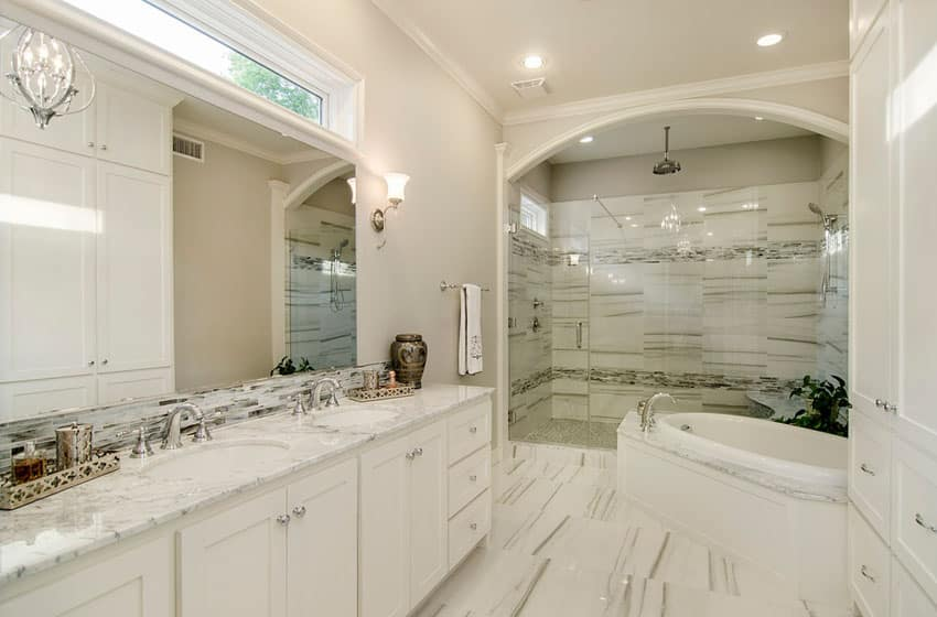 Transitional bathroom with frameless shower marble counters and crown molding