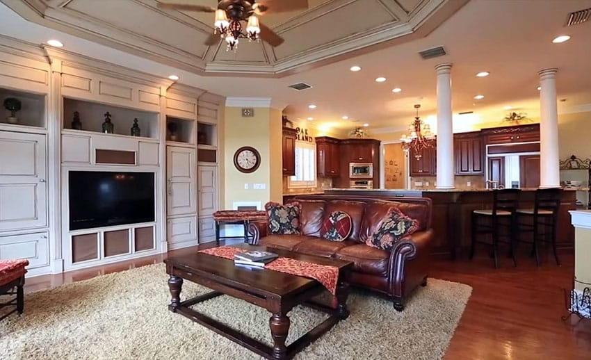 Transitional living room with cream built in entertainment center