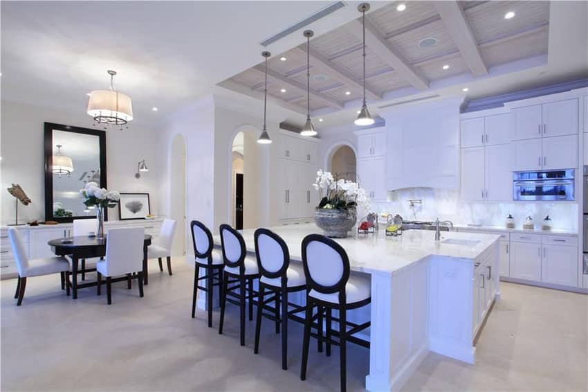 Ultra white cabinet contemporary kitchen with carrara marble counter and open layout