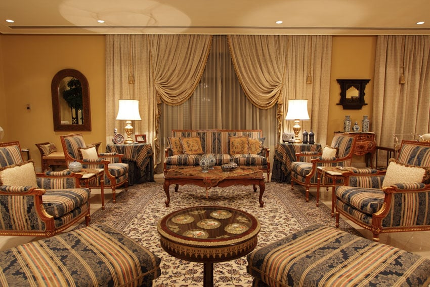 Well appointed luxury living room with matching furniture pieces and floral pattern area rug