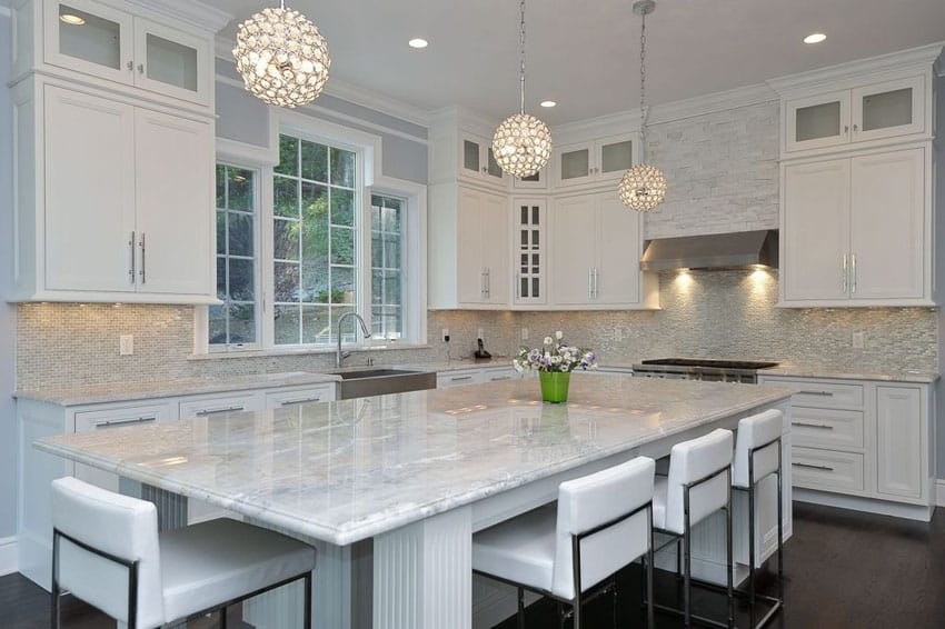 White cabinet kitchen with white wave granite countertops and breakfast bar