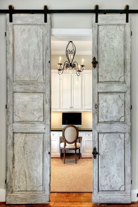 Antique french sliding barn doors leading to home office