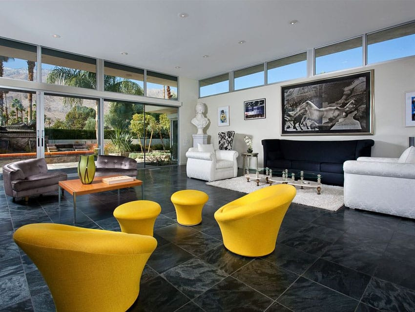 Art deco living room with yellow swivel arm chairs, white chairs and purple chairs