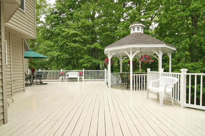 Backyard deck with white gazebo with seating