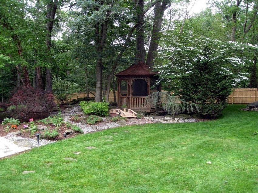 Backyard garden with small wood octagon gazebo