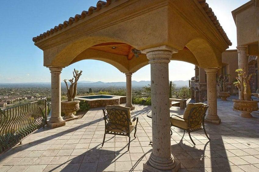 Backyard patio with stone gazebo and hillside views