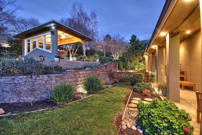 Backyard with custom wood gazebo with outdoor lighting