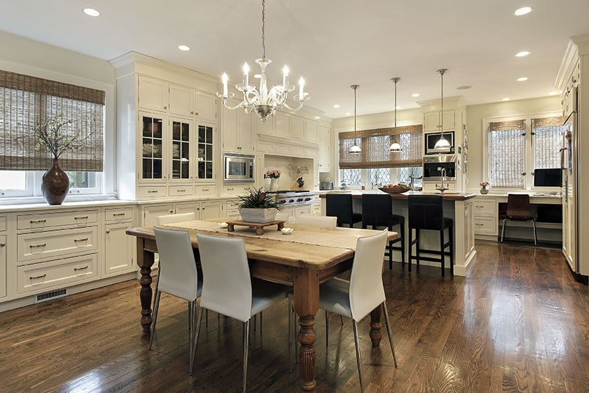 Beautiful cream kitchen with open layout chandelier and pendant lights