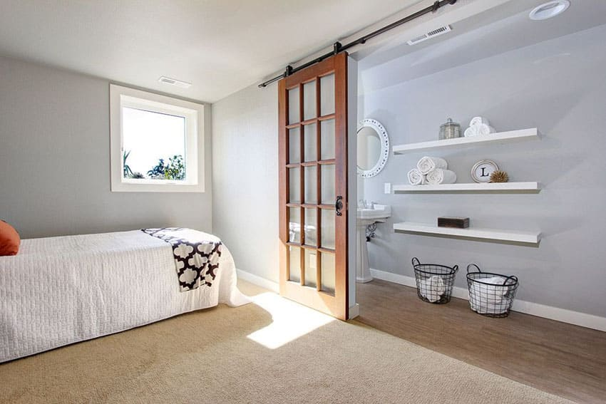 Bedroom with picture window sliding barn door to bathroom