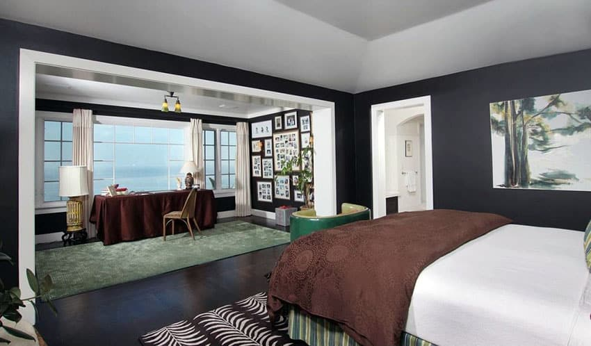 Black bedroom with picture window view of lake