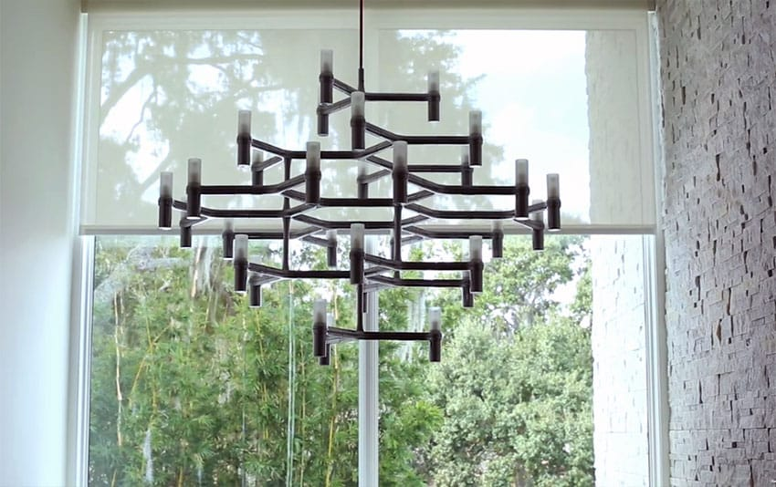 Close up view of custom modern chandelier with outdoor view backdrop