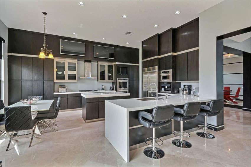 Contemporary dark cabinet kitchen with white counter peninsula