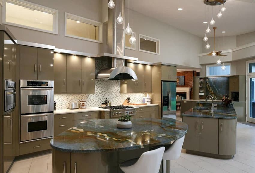 Contemporary kitchen with angola black granite counter, two islands and clear glass wide pendant lighting