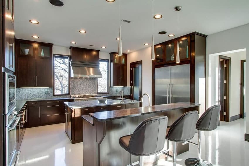 Contemporary kitchen with breakfast bar island, cooking island and satin nickel mini pendant lights