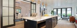 contemporary-kitchen-with-glass-panel-sliding-barn-doors-to-dining-room