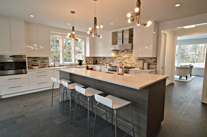 Contemporary kitchen with high gloss white cabinets and felix bar stools