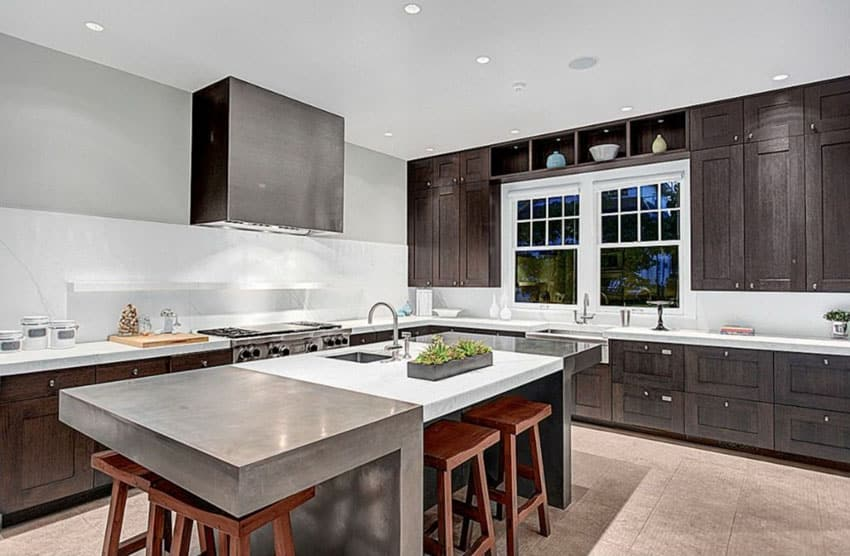 Contemporary kitchen with marble counter island with saddle stool seating