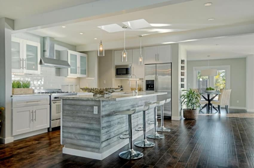 Contemporary kitchen with pebbled glass cylinder pendant lights and subway tile backsplash