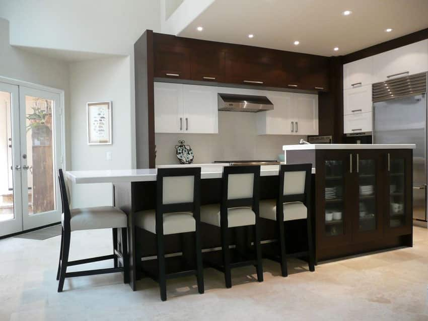 Contemporary kitchen with quartz breakfast bar and white and brown cabinets