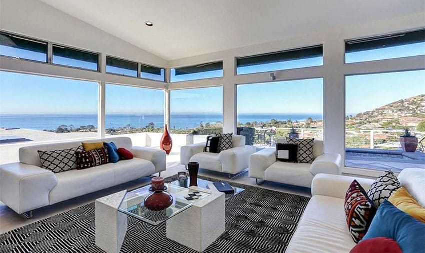 Contemporary white furniture living room with expansive ocean views