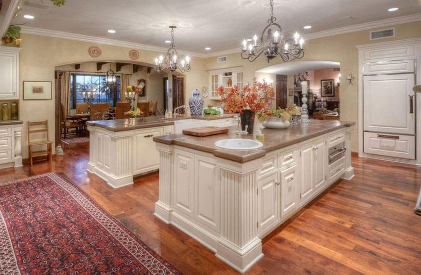 Country kitchen with two large islands and rustic chandeliers