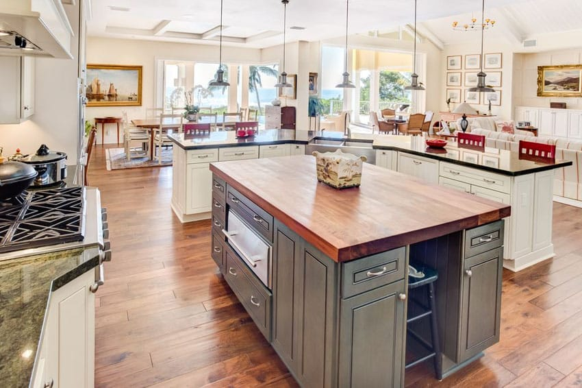Country kitchen with wood counter island and granite breakfast bar island