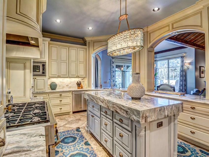 Cream cabinet traditional kitchen with augusta white marble counter and narrow island