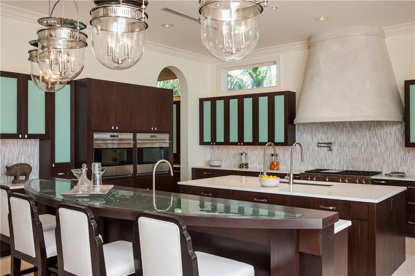 Eclectic kitchen with curved breakfast bar and custom range hood