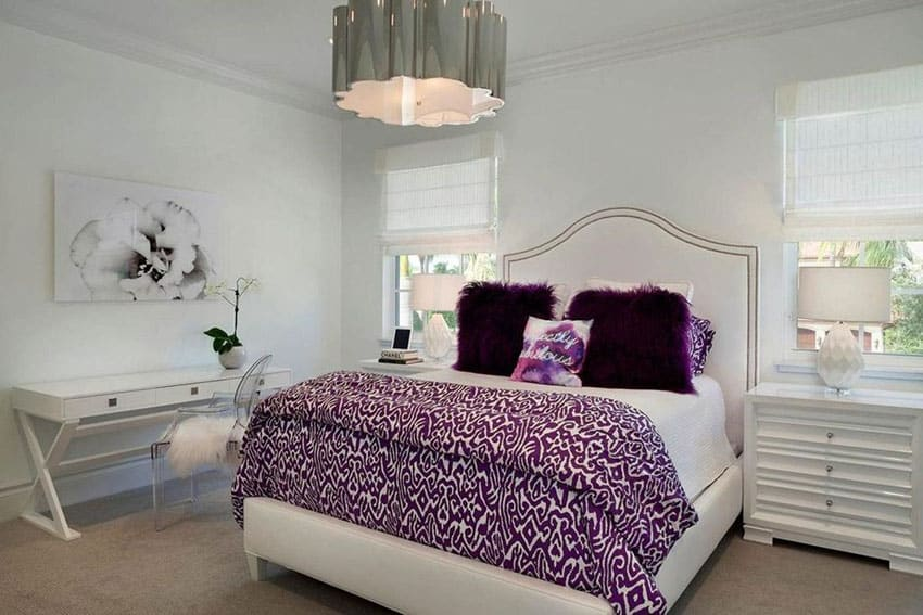 white bedroom with drum pendant light and purple accent colors