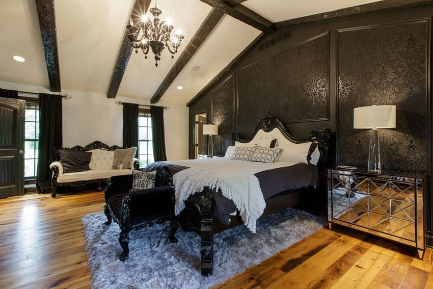 Elegant traditional bedroom with black patterned wall and chandelier