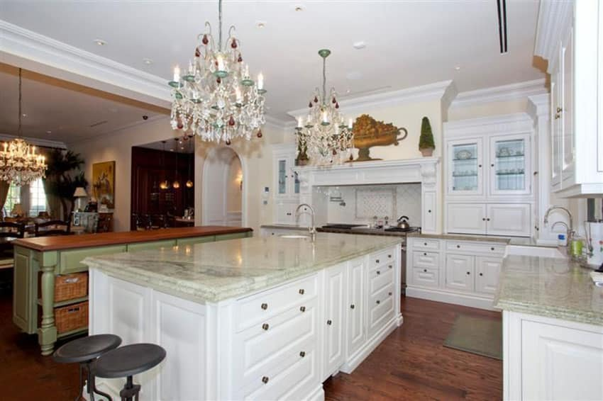 Elegant white cabinet kitchen with persian green marble counter island and green painted island with wood counter