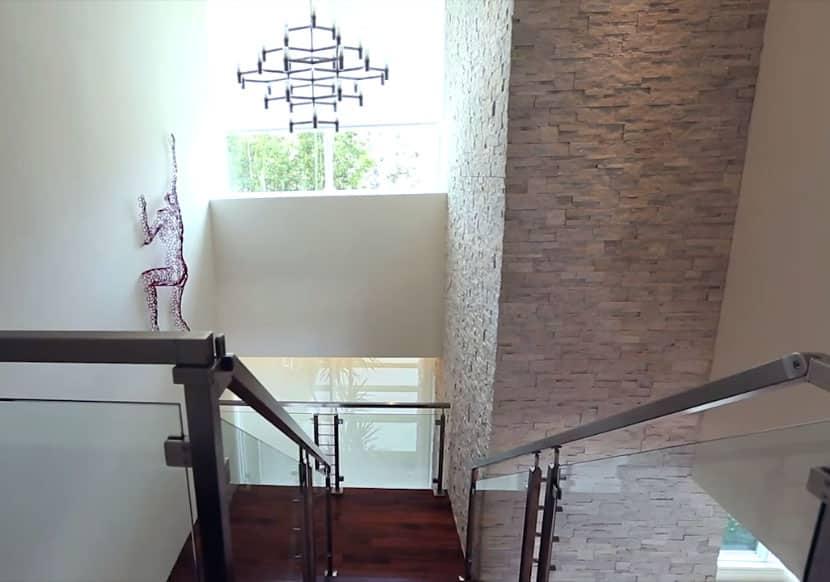 Interior design modern home with climbing man wall art and custom chandelier