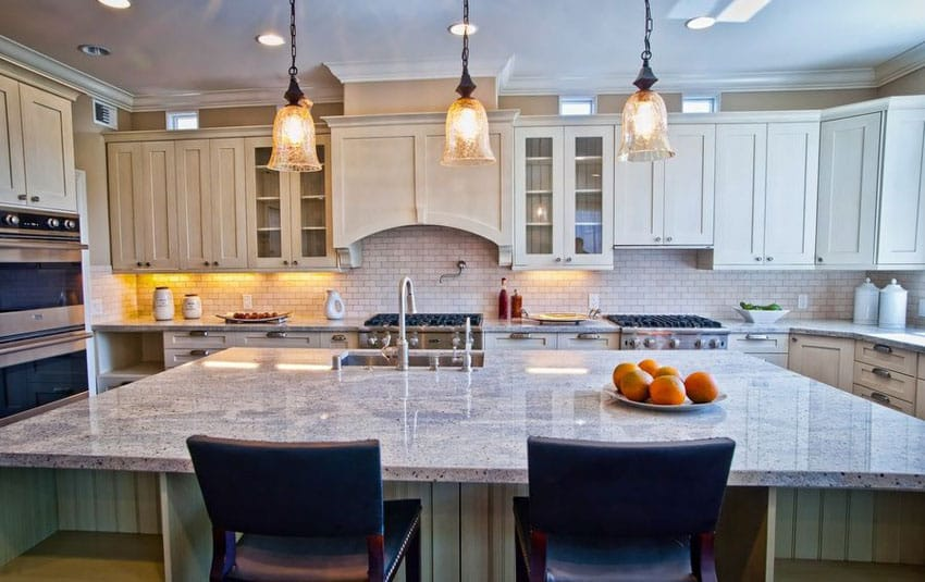 Kitchen with large island with bianco catalina granite and seating