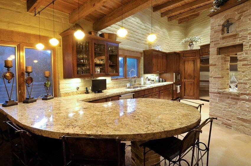 Kitchen with peninsula and new venetian gold granite counter