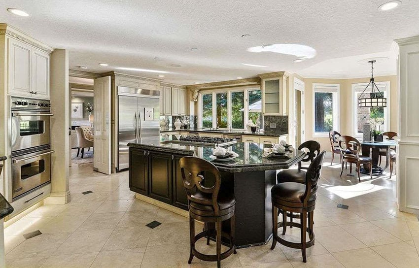 Kitchen with unusually shaped island with breakfast bar dining and vienna swivel counter stools