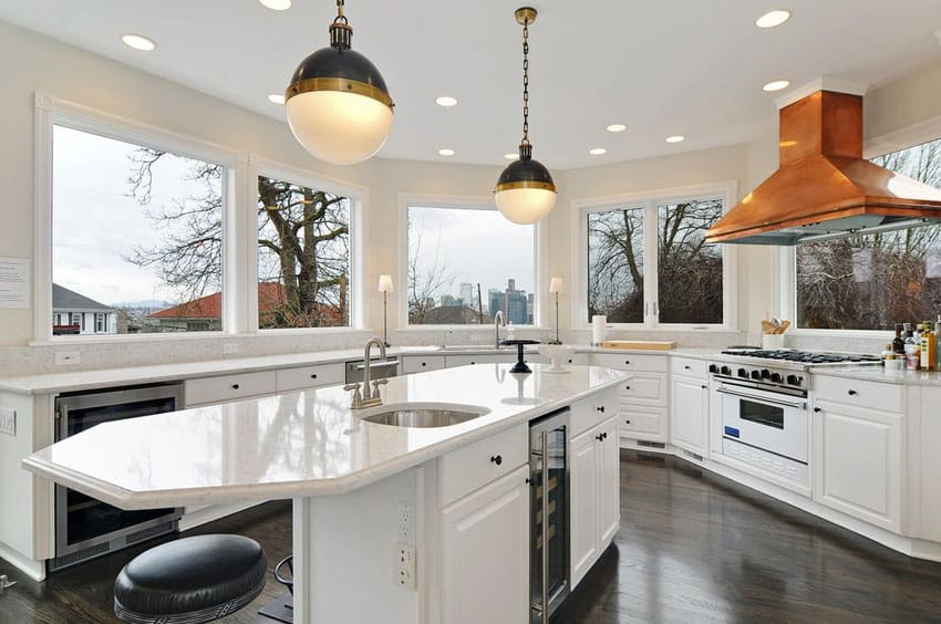 Kitchen with wrap around window views, white cabinets, marble counters and darkened hickory floors