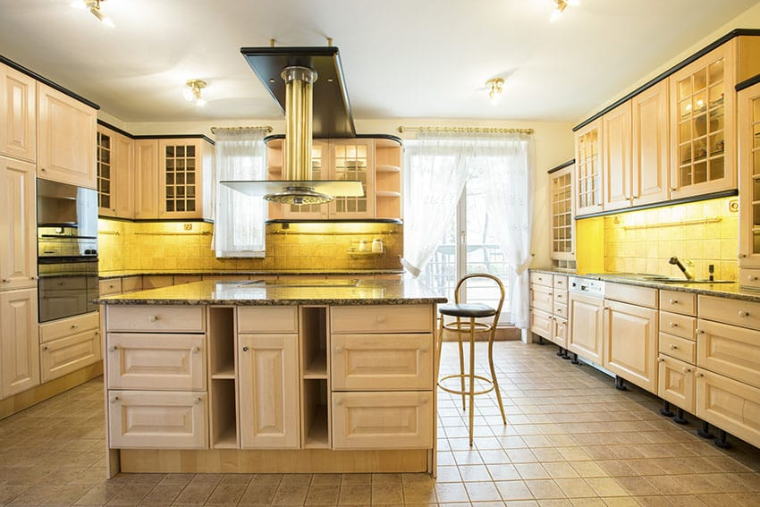Large kitchen with cream cabinets and under cabinet lighting