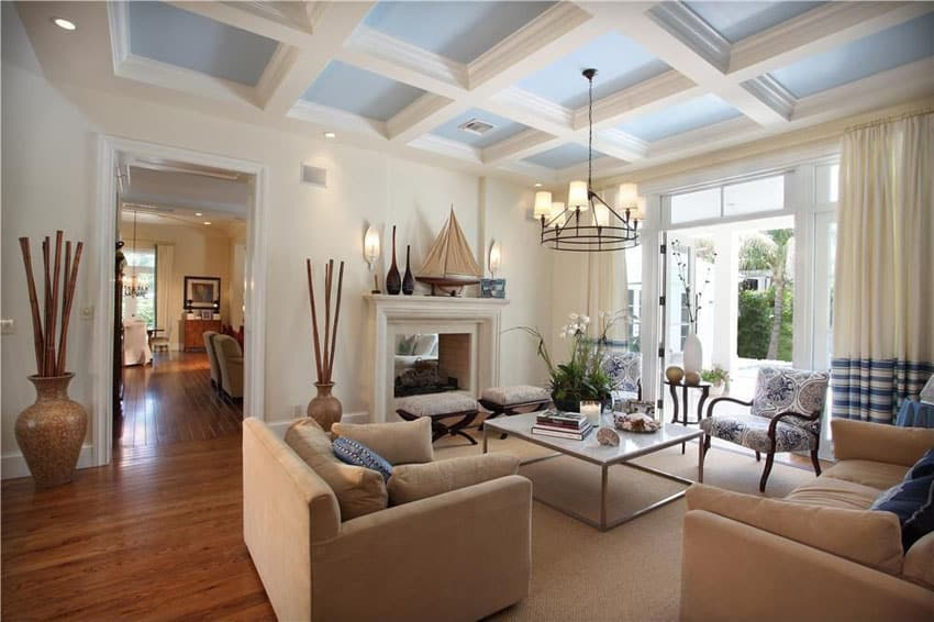 Lovely living room with blue box ceiling and wood flooring