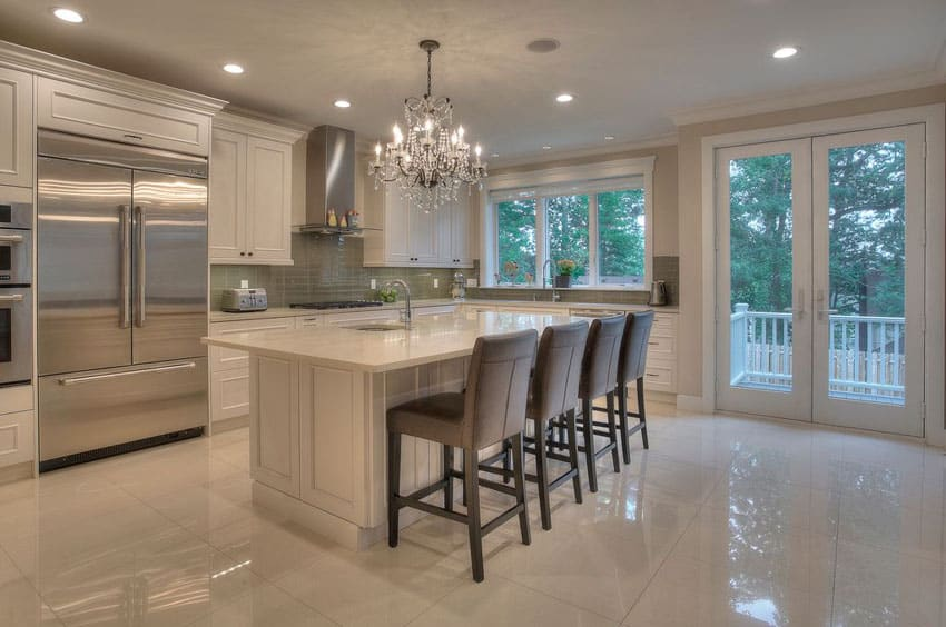 Luxury kitchen with cream cabinets, marble counter island with marble flooring