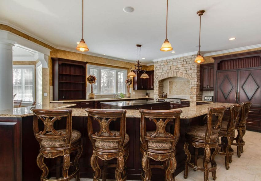 Luxurious kitchen with long dining bar island with bar stools and seating for 6 and middle island for cooking