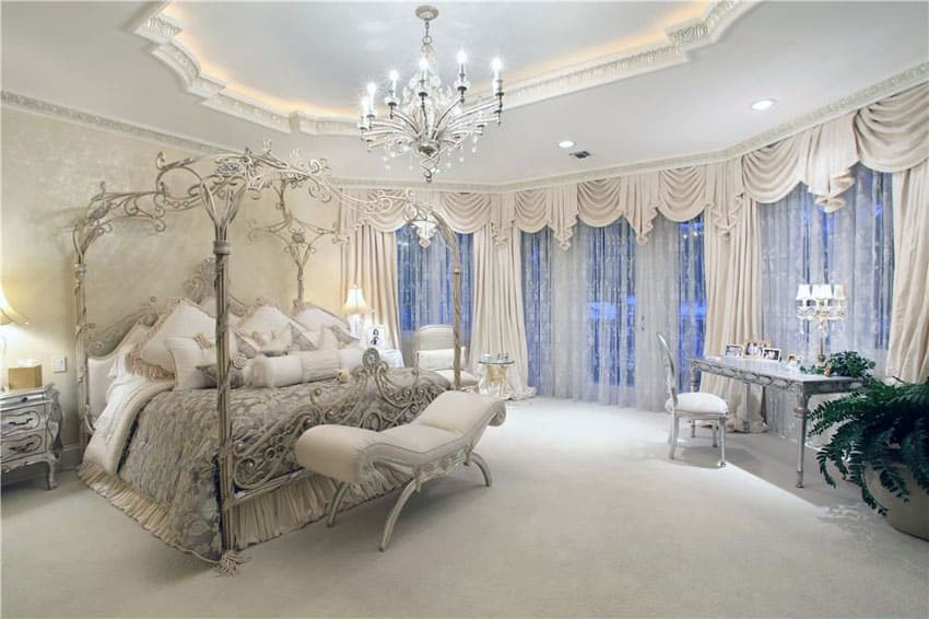 Luxury bedroom with canopy bed, Victorian style furniture and chandelier