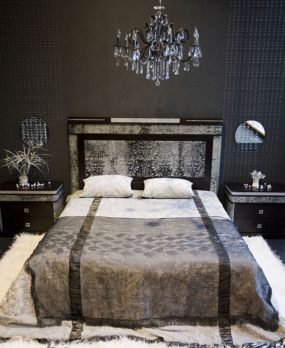Luxury black decorated bedroom with chandelier