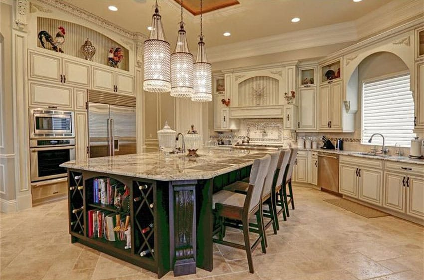 Luxury cream cabinet kitchen with green breakfast bar island and honed travertine floors