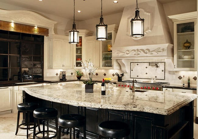 Luxury kitchen island with snowfall granite counters and dark under cabinet