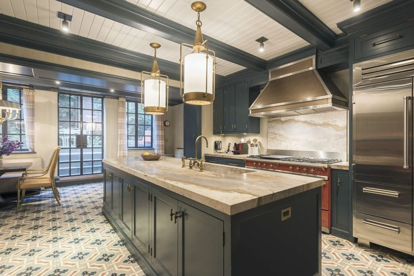 Luxury kitchen with black cabinets, beige marble counters and exposed beams ceiling