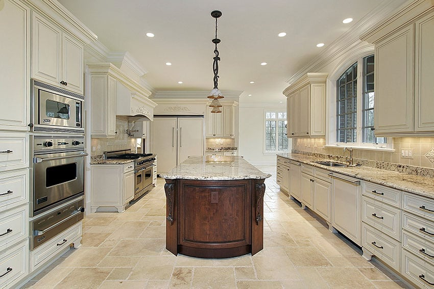 Luxury kitchen with cream cabinets and brown island with beige granite