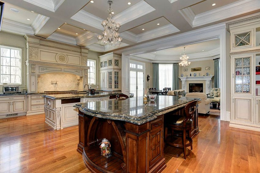 Luxury kitchen with decorative wood island with breakfast bar and pental kozmus satin granite counter