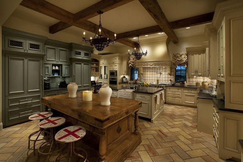 Luxury French antique kitchen with reclaimed pine island and cooking island with herringbone terracotta flooring