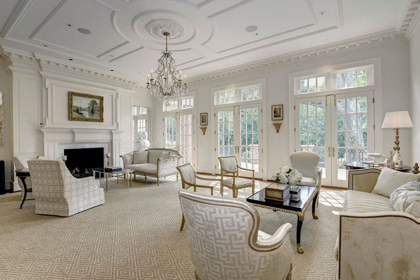 Luxury living room with Hampton design, fireplace, chandelier and Louis xvi armchairs